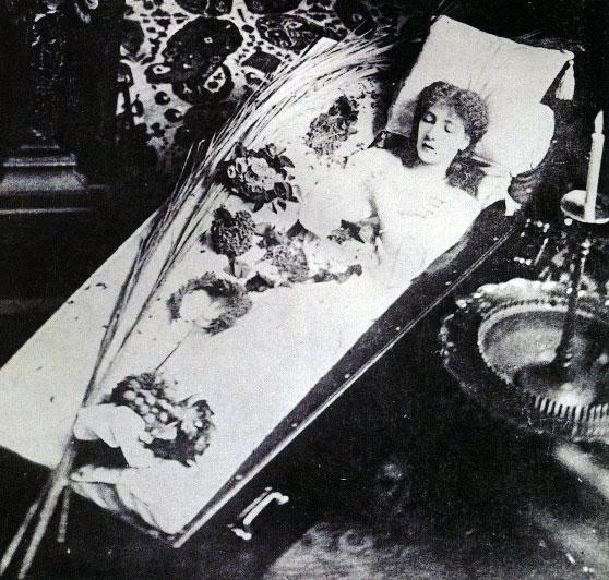 Sarah Bernhardt posing in a coffin